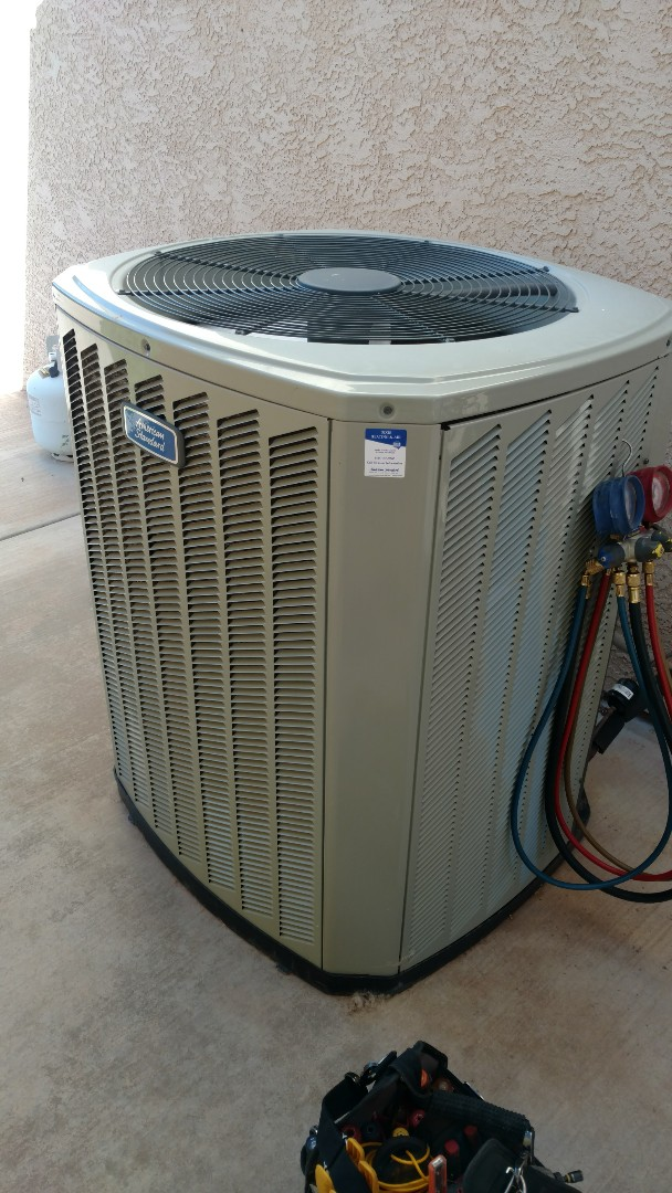 Ivins, UT - Dixie Heating and Air Conditioning performing routine maintenance on American Standard AC split system