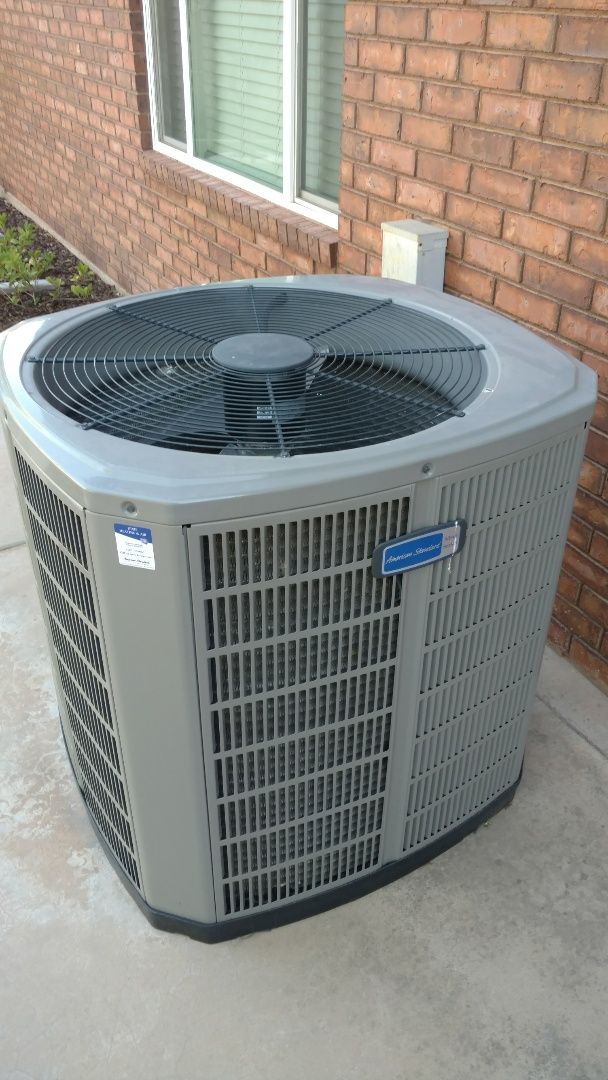 St. George, UT - Dixie Heating and Air Conditioning replacing warranty condenser fan motor on American Standard Heat Pump