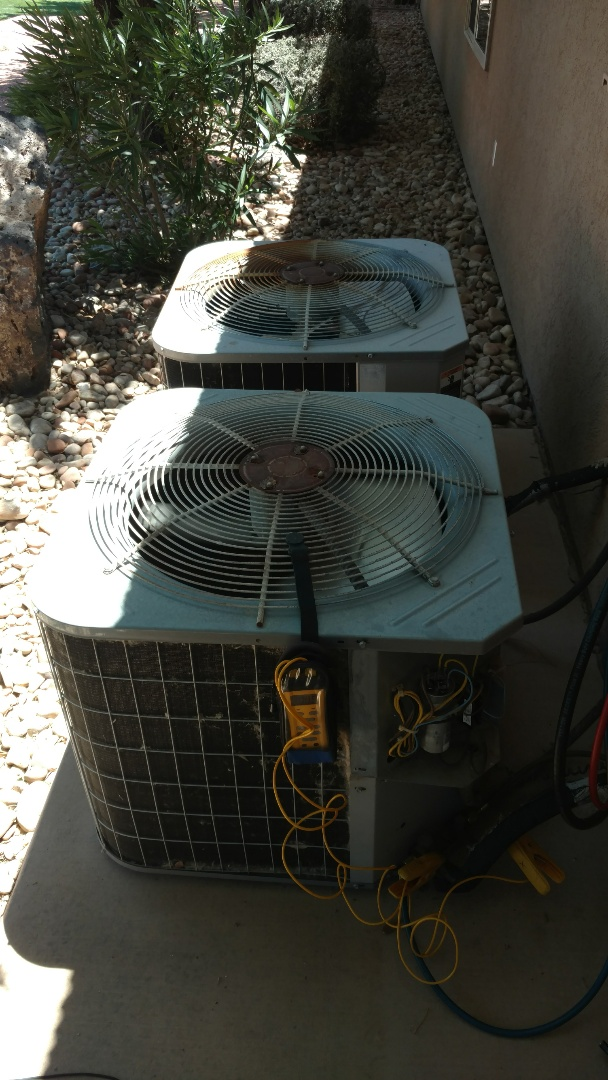 St. George, UT - Dixie Heating and Air Conditioning replacing bad dual capacitor on Bryant AC split system