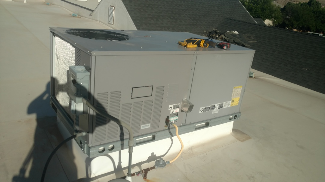 St. George, UT - Dixie Heating and Air Conditioning diagnosing bad compressor on Carrier rooftop unit