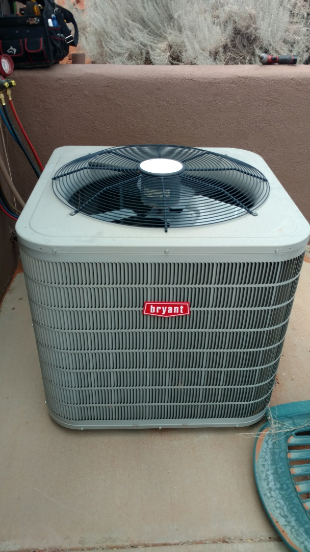 Ivins, UT - Dixie Heating and Air Conditioning replacing bad dual capacitor on Bryant Heat Pump split system