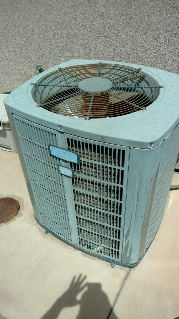 Washington, UT - Dixie Heating and Air Conditioning adding 2 1/2 lbs of refrigerant to American Standard AC system