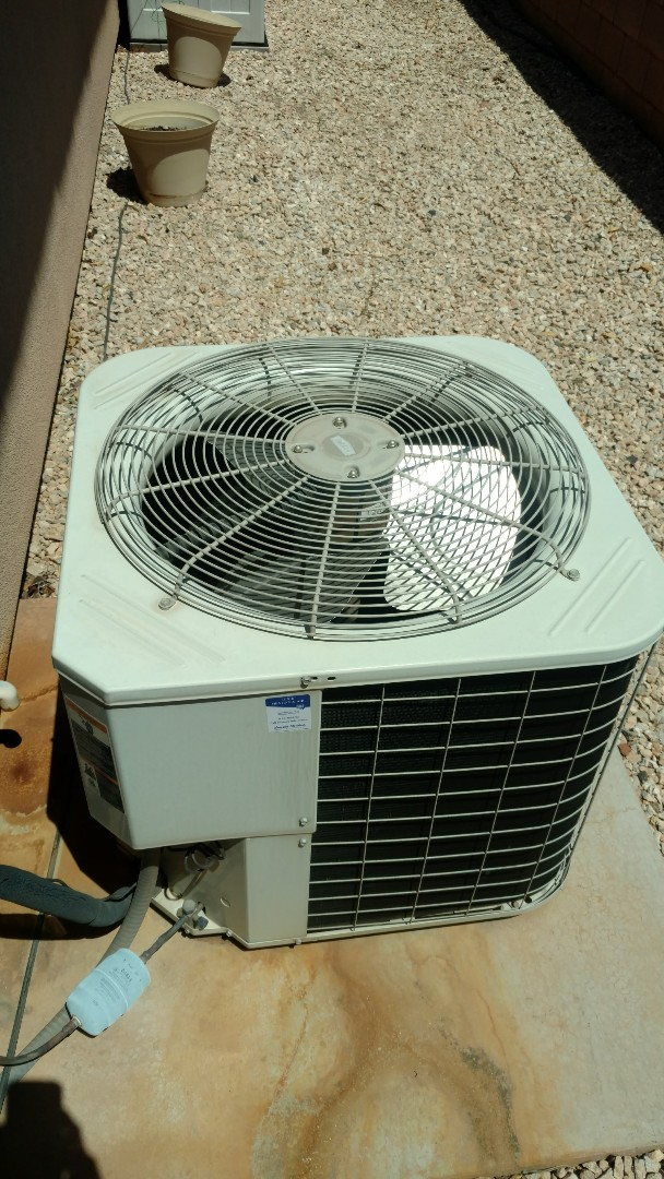 Washington, UT - Dixie Heating and Air Conditioning replacing bad capacitors on two Bryant AC split systems