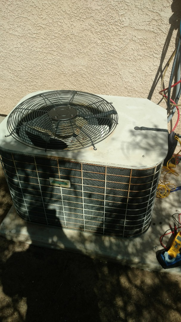 Toquerville, UT - Dixie Heating and Air Conditioning diagnosing leak in refrigerant system in ole Coleman AC split system