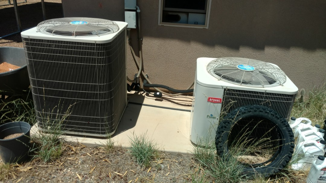 Hurricane, UT - Dixie Heating and Air Conditioning replacing bad dual capacitor on Bryant AC split system