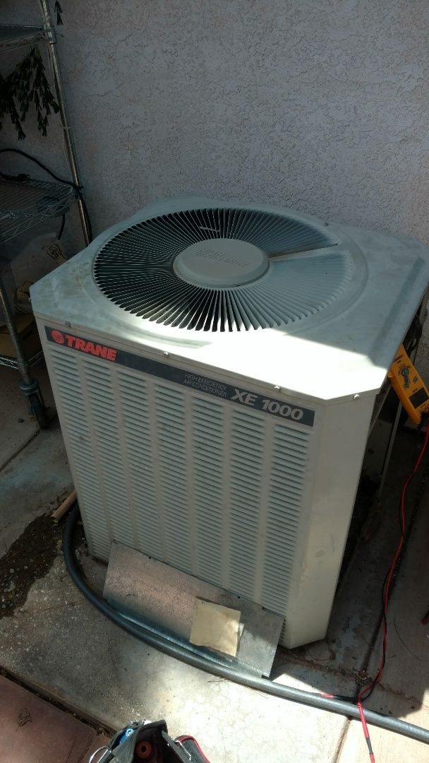 St. George, UT - Dixie Heating and Air Conditioning replacing bad condenser fan motor and dual capacitor on American Standard AC split system