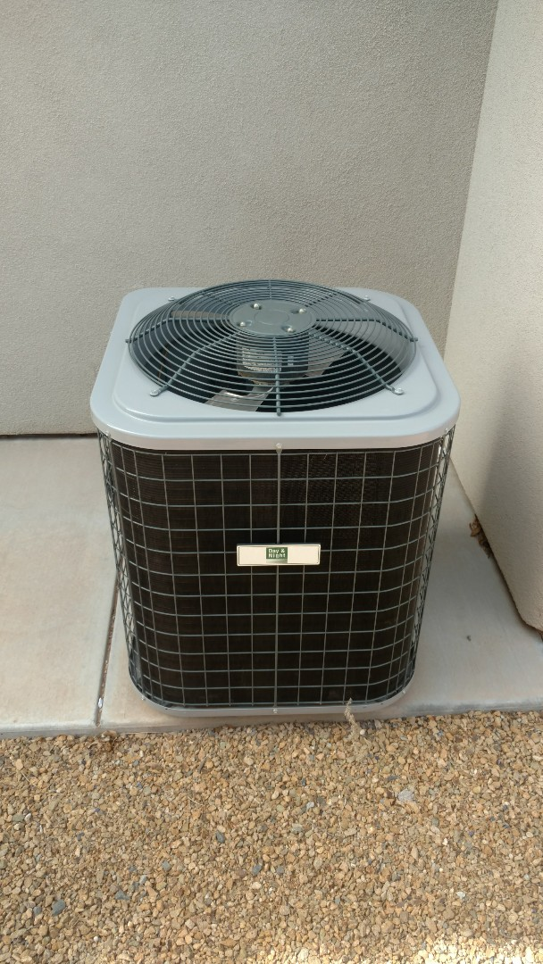St. George, UT - Dixie Heating and Air Conditioning replacing bad dual capacitor on Day and Night Heat Pump split system