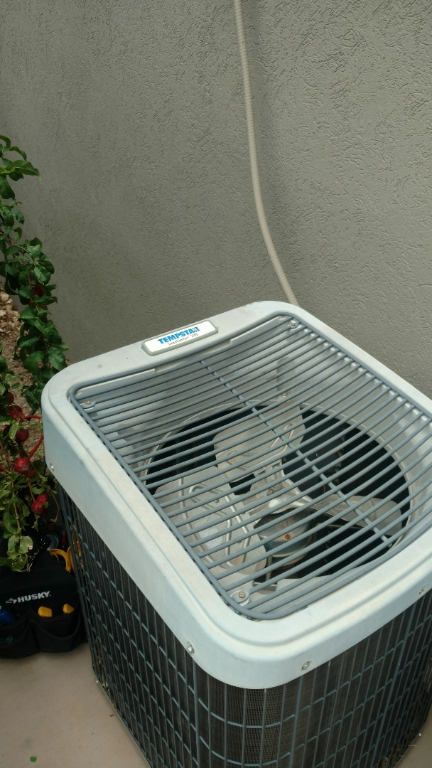St. George, UT - Dixie Heating and Air Conditioning repairing leak in refrigerant piping on Tempstar AC split system
