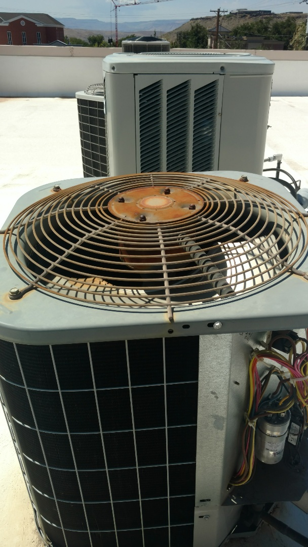 St. George, UT - Dixie Heating and Air Conditioning replacing bad dual capacitor on Carrier AC split system