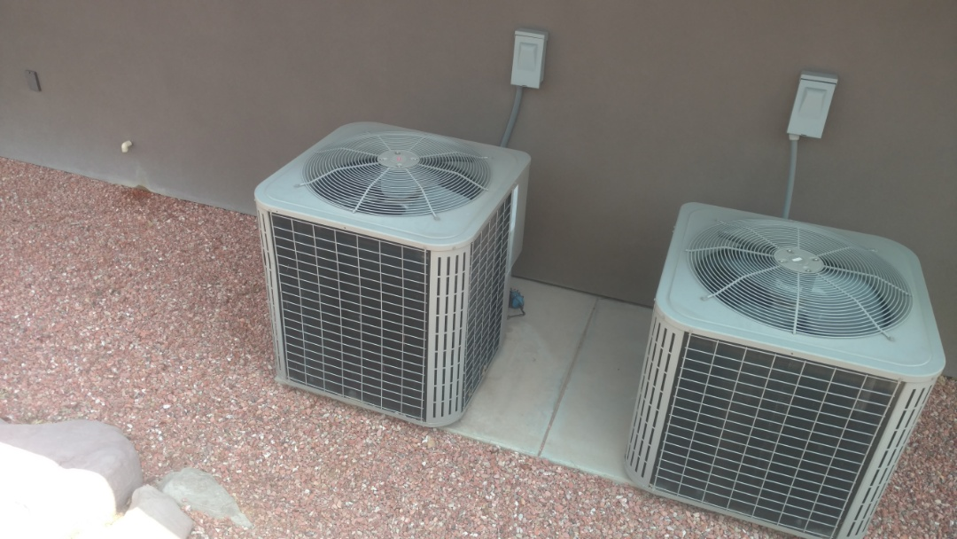 St. George, UT - Dixie Heating and Air Conditioning replacing bad condenser fan motor and dual capacitor on Bryant split system