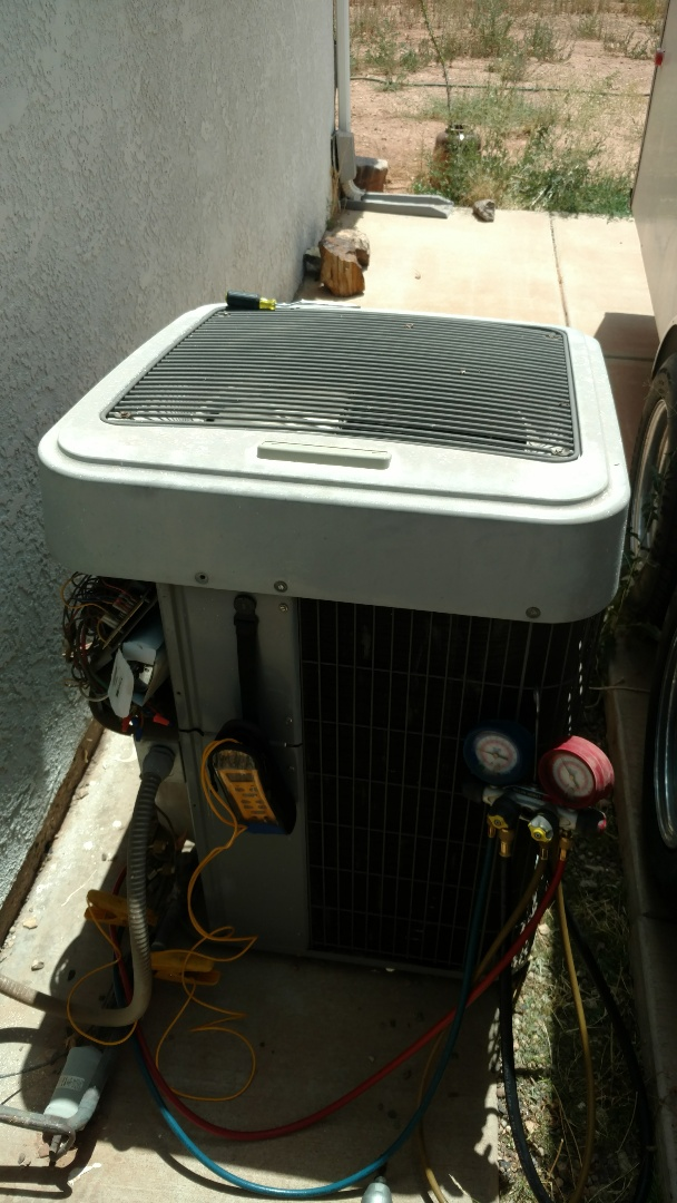 St. George, UT - Dixie Heating and Air Conditioning replacing bad dual capacitor, tightening motor mount and leveling Tempstar Heat Pump split system