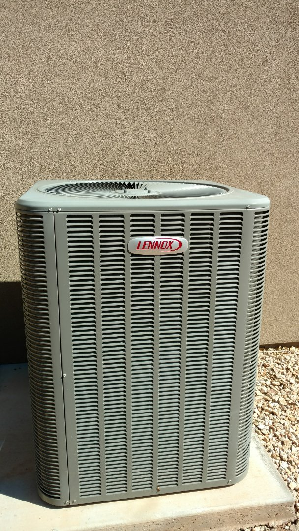 St. George, UT - Dixie Heating and Air Conditioning replacing bad dual capacitor on Lennox Heat Pump split system