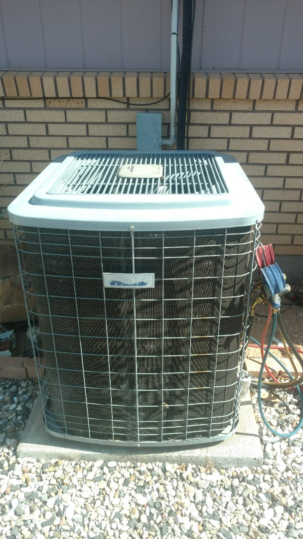 St. George, UT - Dixie Heating and Air Conditioning replacing bad dual capacitor on Heil heat pump split system