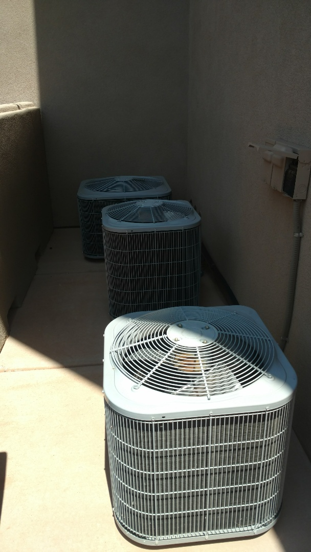 Washington, UT - Dixie Heating and Air Conditioning replacing bad dual capacitors on two Carrier AC and removing refrigerant and filter drier and adding new