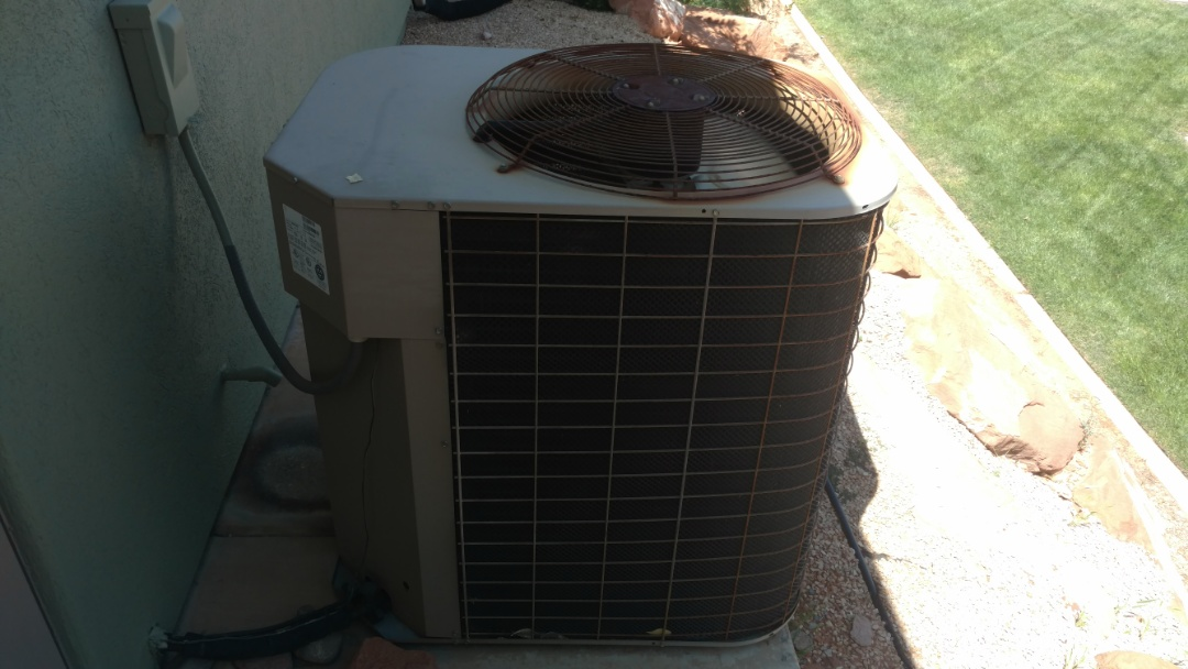 Washington, UT - Dixie Heating and Air Conditioning performing routine maintenance on York AC split system