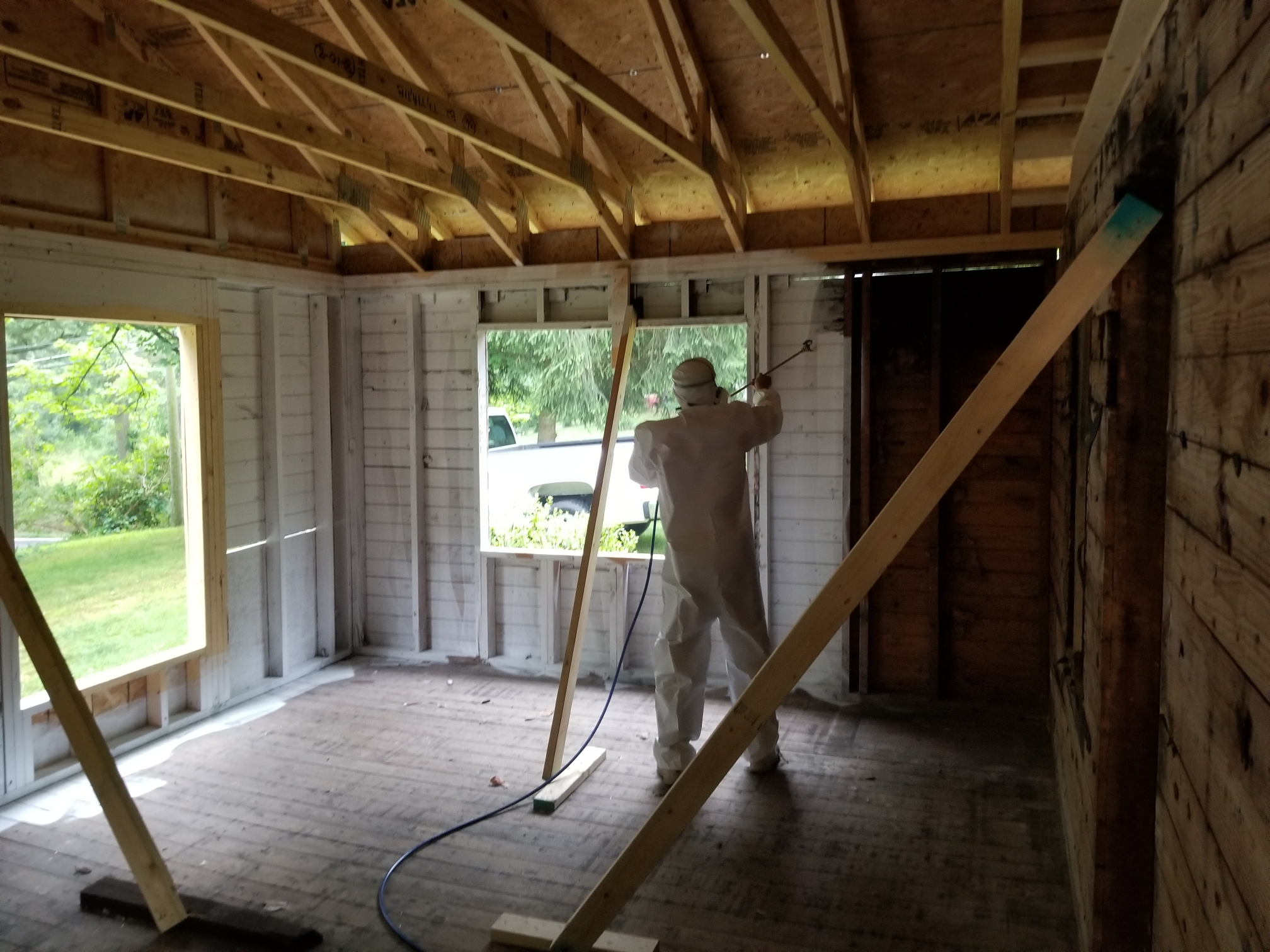 Elkton, MD - Spraying primer to lock down the smoke smell at this fire restoration