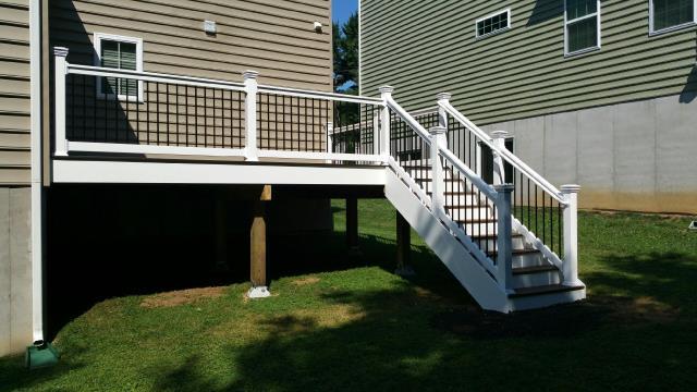 Newark, DE - A Trex Transcend Composite deck with vinyl railing and black round balusters.