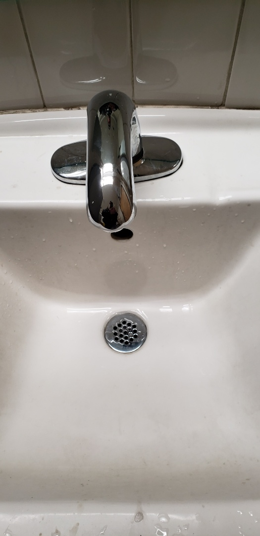Whitehall, PA - Bathroom sink leaking faucet repair.  Plumbing service call near Whitehall