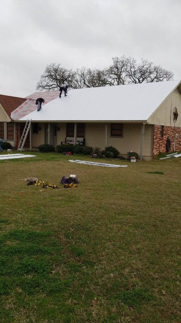 Cleburne, TX - Installing a new class 4 metal roof. This will allow the customer to get 15% off of homeowners insurance.  A metal roof at an affordable price.