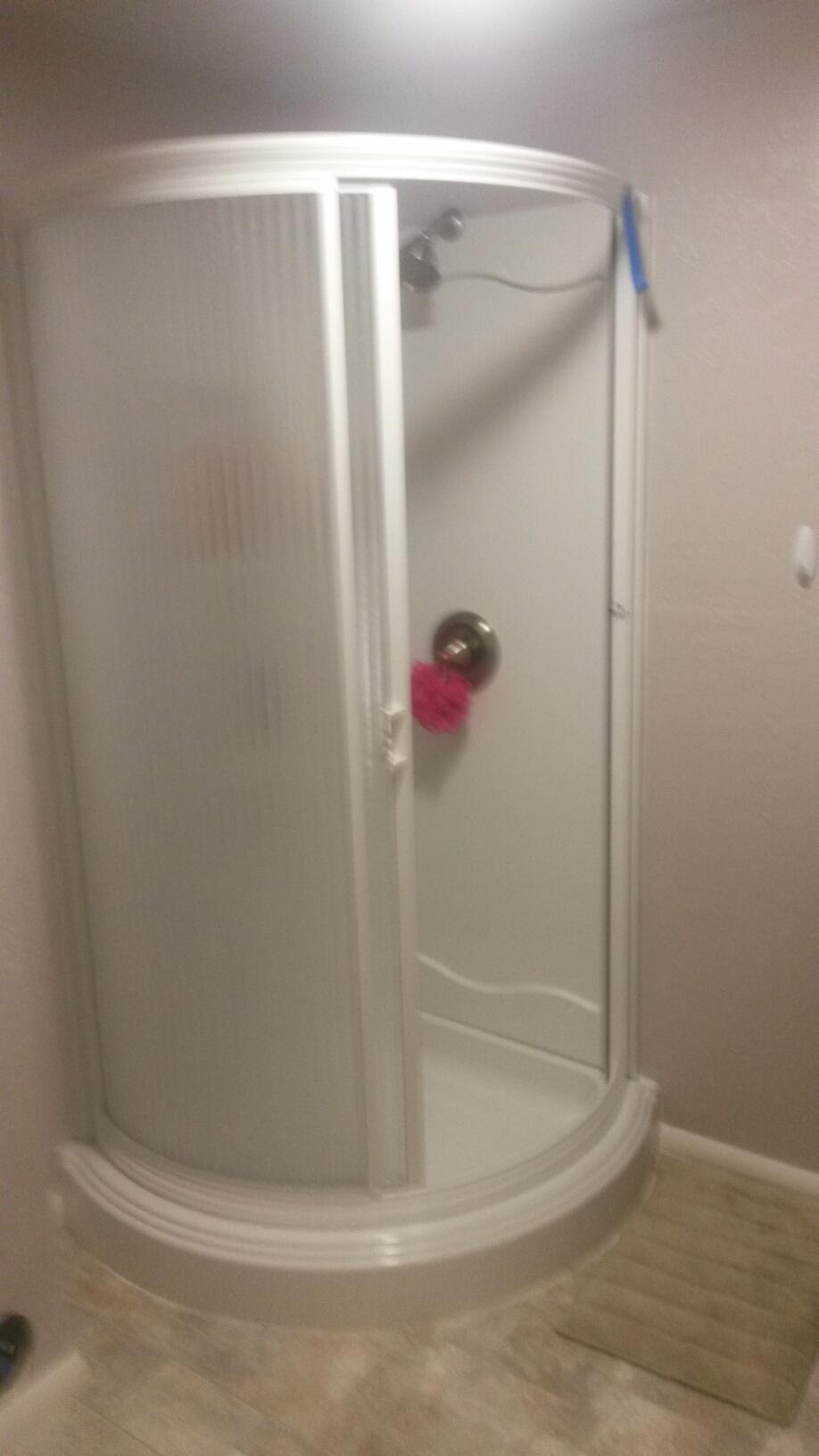Ogden, UT - New corner shower installed after water damage in the basement bathroom.