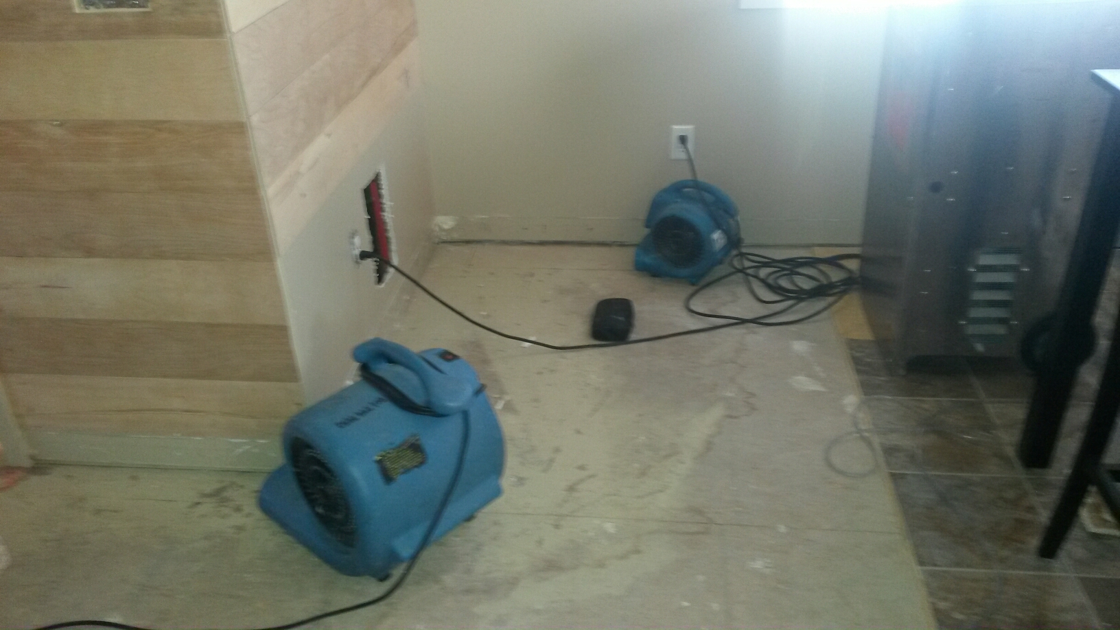 Farmington, UT - Monitoring the drying progress in this Farmington Utah home. The walls are dry, osb subfloor is slower to dry it will still take another day or two.