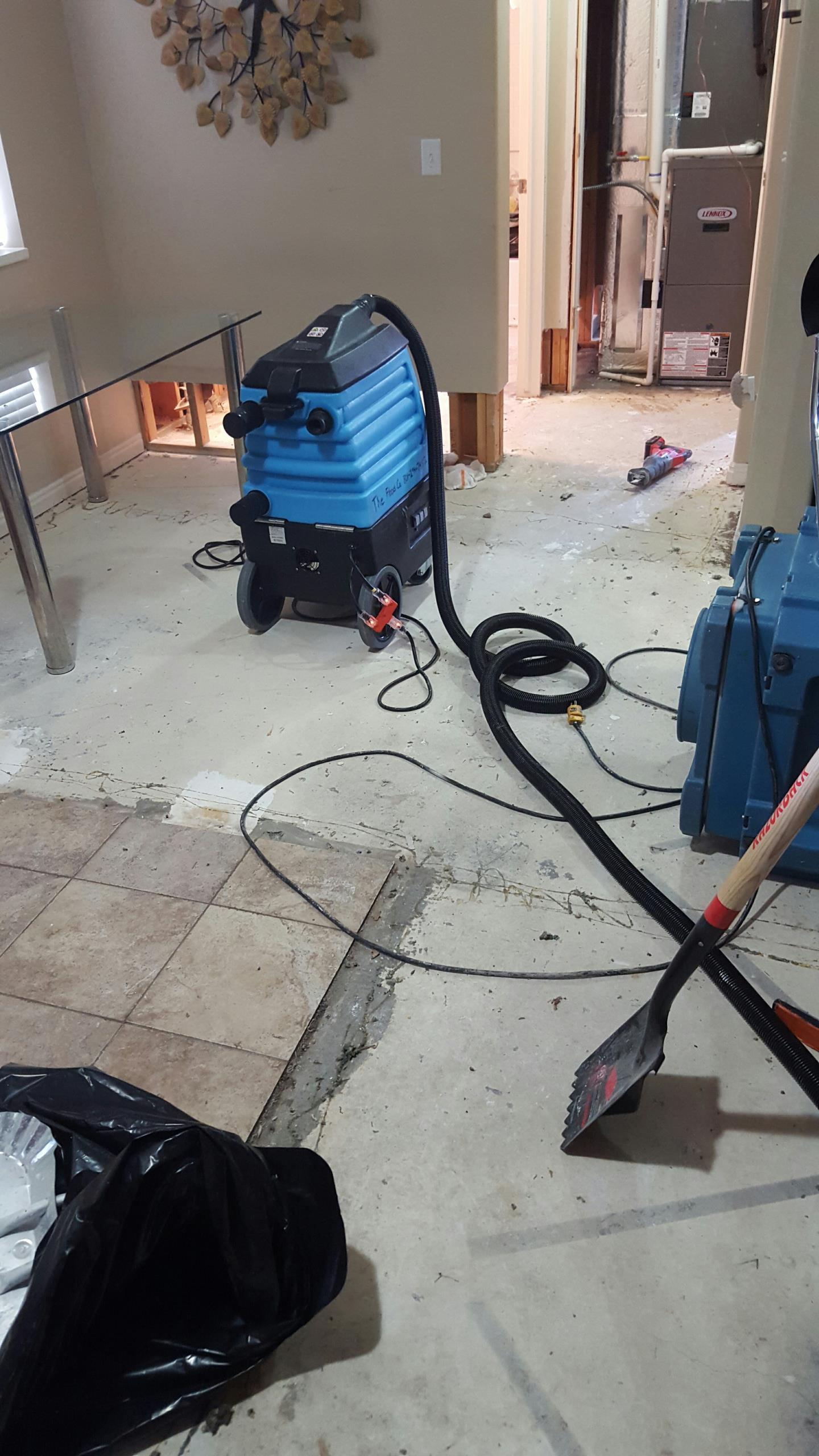 North Salt Lake, UT - Water damage from a sewer backup in North Salt Lake. Carpet was removed and drywall cuts were made to prevent mold growth.