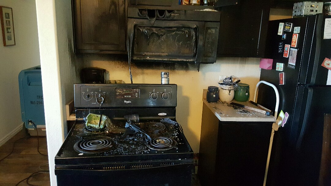 Murray, UT - Fire Damage that caused sprinkler system to flood apartment in Murray. A small kitchen fire can cause a lot of damage throughout the rest of a dwelling. Three floors effected by water damage.