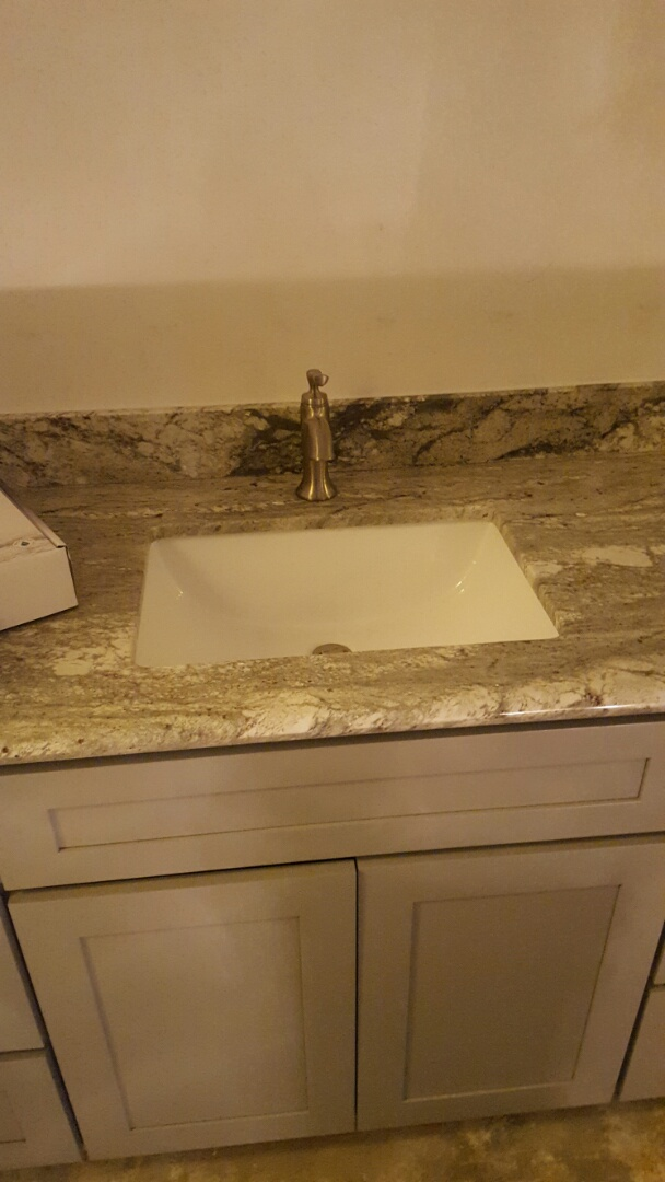 Riverside, CA - Installing a new faucet and waste and drain for the sink