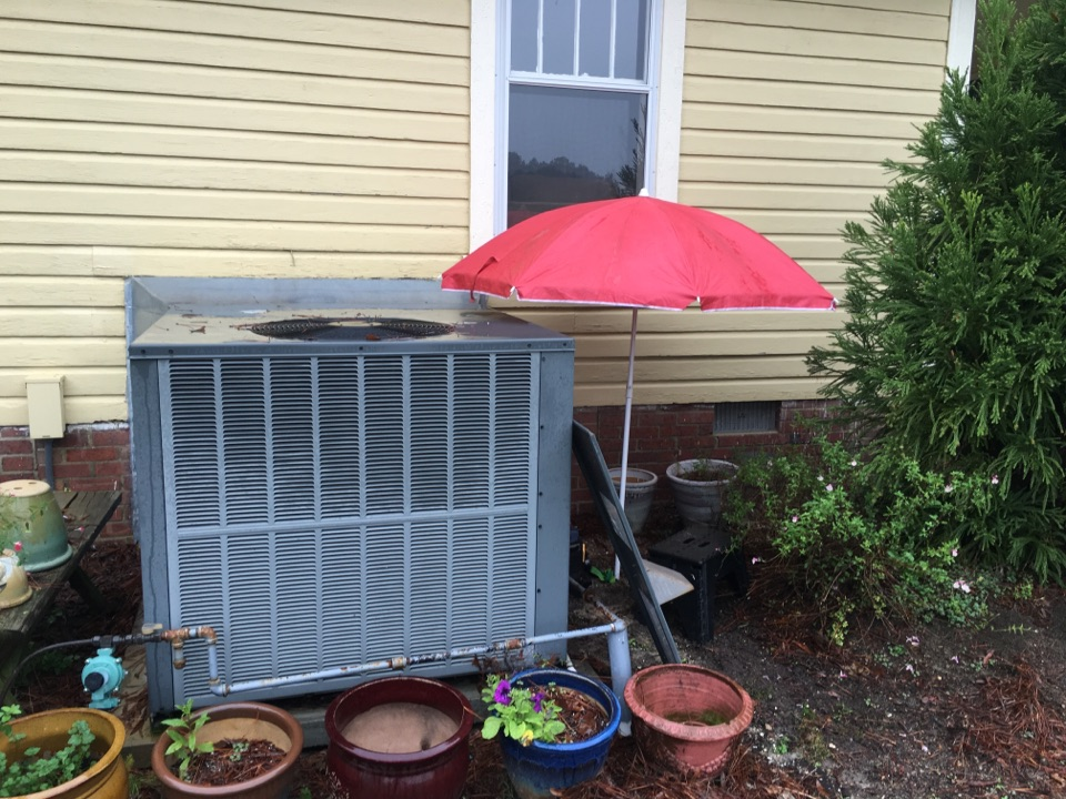 New Hill, NC - Performing heating maintenance on amana gaspack