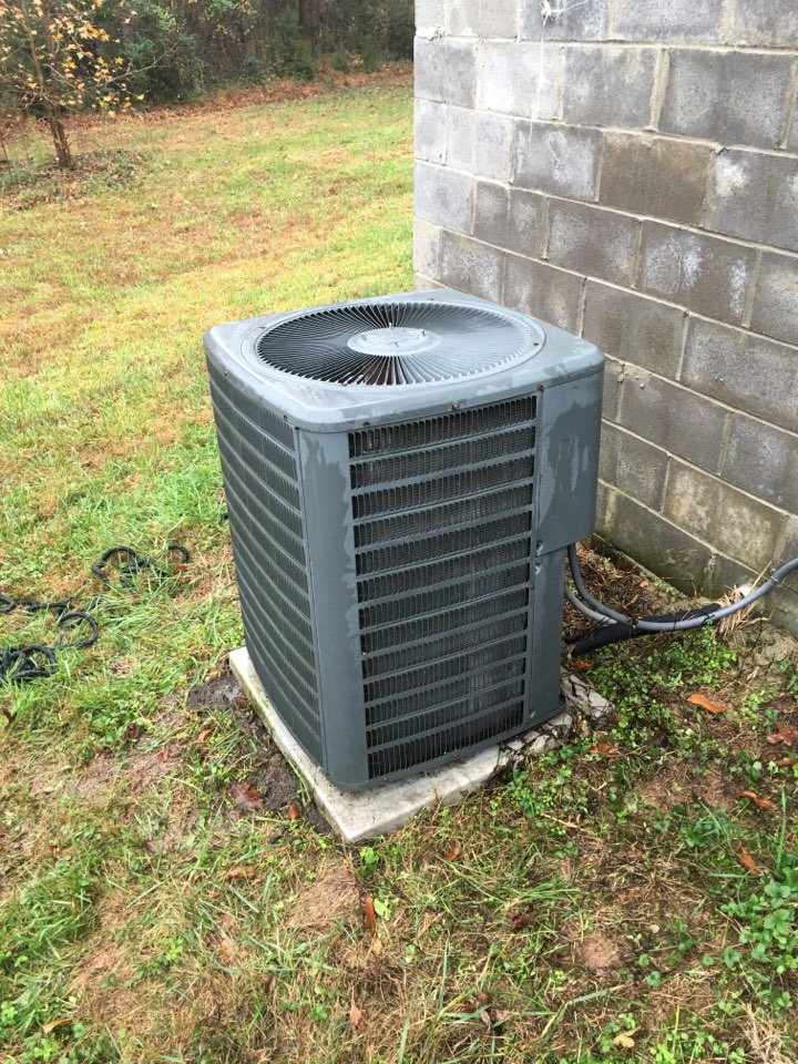 Bear Creek, NC - Performing heating maintenance on Amana hvac heat pump