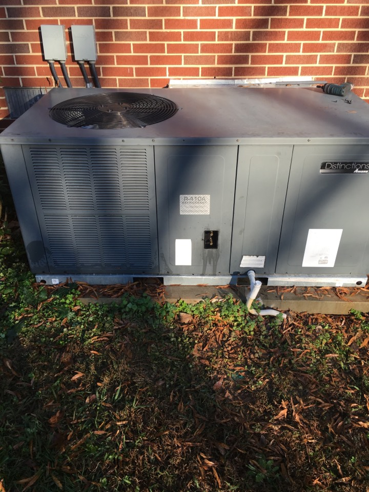 Bear Creek, NC - Performing heating maintenance on Amana hvac heat pump pack