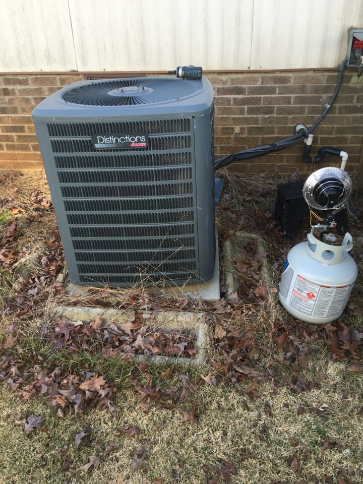 Moncure, NC - Performing heating maintenance on Amana heat pump