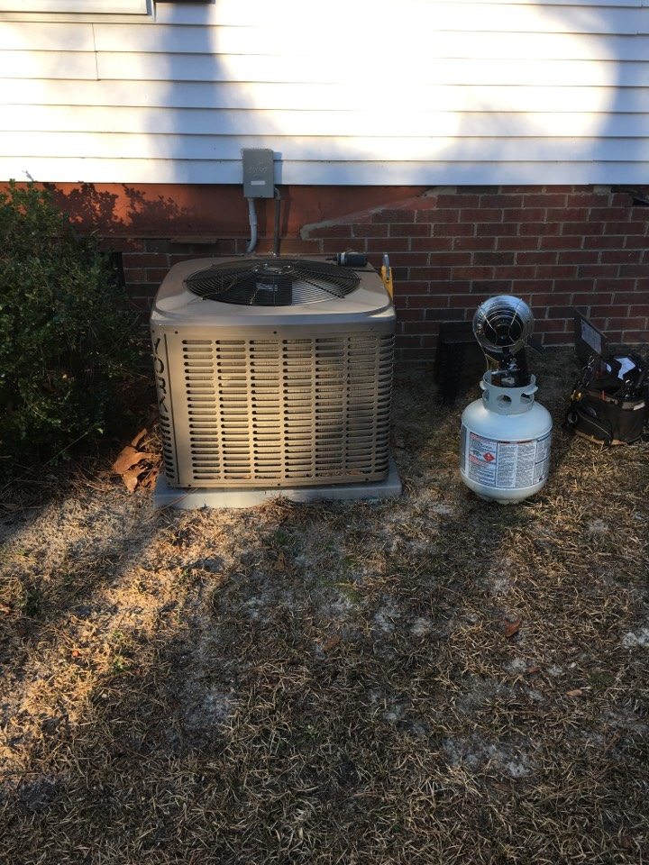 Carthage, NC - Performing heating maintenance on York heat pump