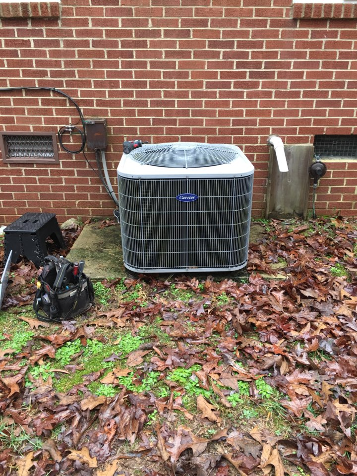 Bear Creek, NC - Performing heating maintenance on carrier dual fuel heat pump