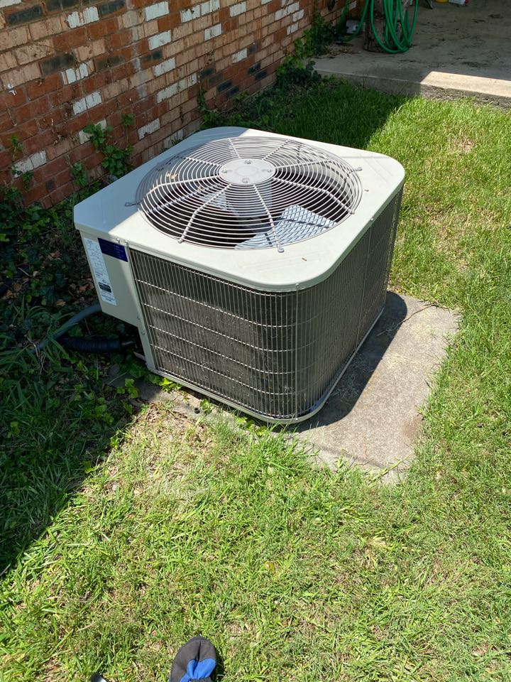 Haltom City, TX - Emergency AC repair in Haltom city Texas working on a carrier air-conditioning system replaced the capacitor and charged unit with refrigerant