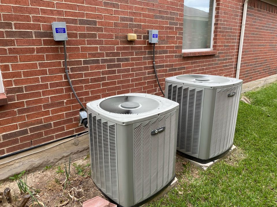 Fort Worth, TX - AC service and repair west Fort Worth working on a pair of Trane air conditioners had to charge them up with refrigerant 22 systems are working good now