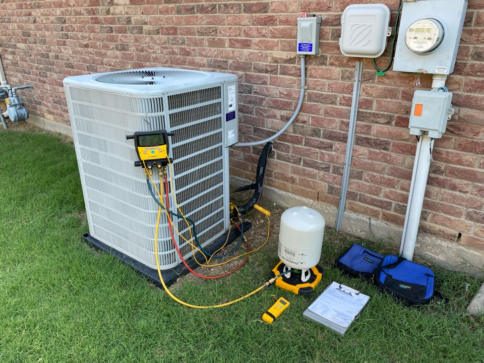 Saginaw, TX - Air conditioning service and repair in Saginaw Texas working on a Concorde air conditioner had to charge the unit with some refrigerant 410 a system seems to be cooling good at this time we may have to return and do an electronic leak detection