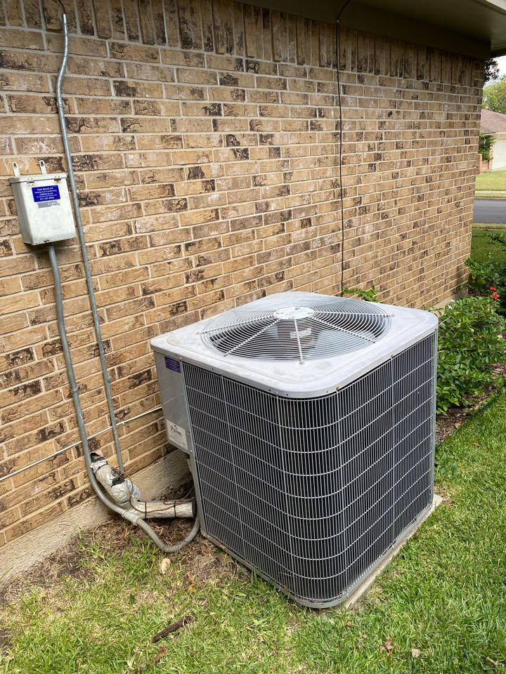 Benbrook, TX - Emergency heating and air-conditioning repair Contractor serving Benbrook Texas working on a carrier air-conditioning system replacing a dual run capacitor and added just a little bit of refrigerant