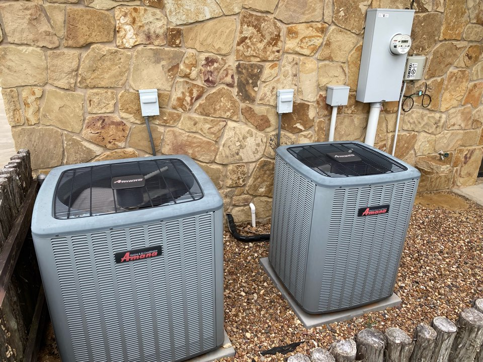 Fort Worth, TX - AC and heating repair service maintenance tuneup's on residential air-conditioning equipment in Burton Hills Trinity trails neighborhood in Westworth Village Fort Worth Texas