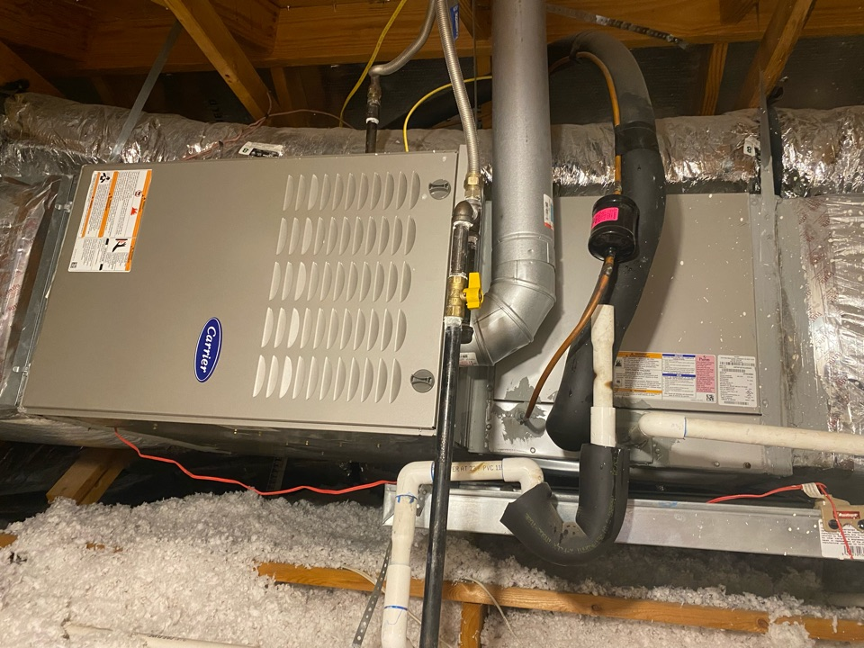 North Richland Hills, TX - Heating and air-conditioning repair service today we repaired a carrier air conditioner had to blow out the condensation drain lines and also charge the unit with a little bit of refrigerant the AC is cooling much better now