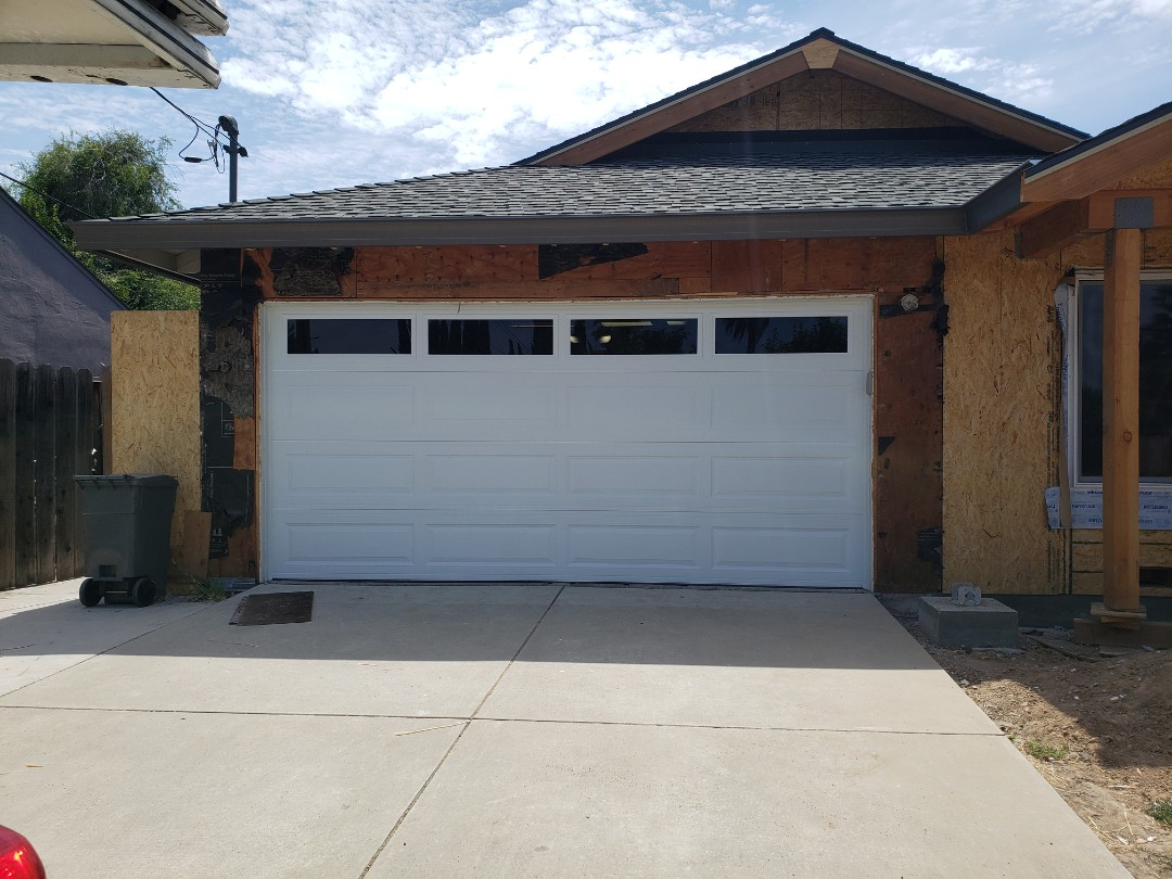 Install new garage door. 15x7 Amarr Stratford 3000 Liftmaster WLED