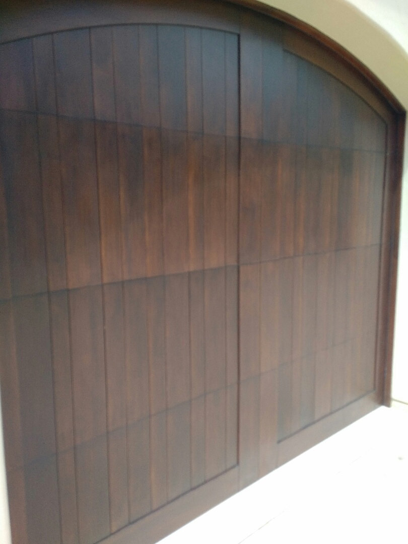 Service garage doors .lubricate and adjust Springs on wood garage doors