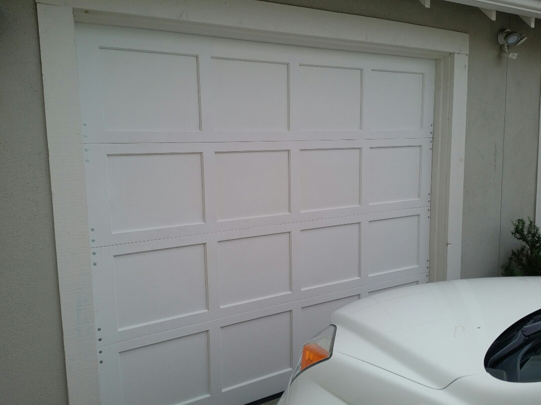 Santa Cruz, CA - Duplicate and replace custom wood garage door that had been crashed into by a car