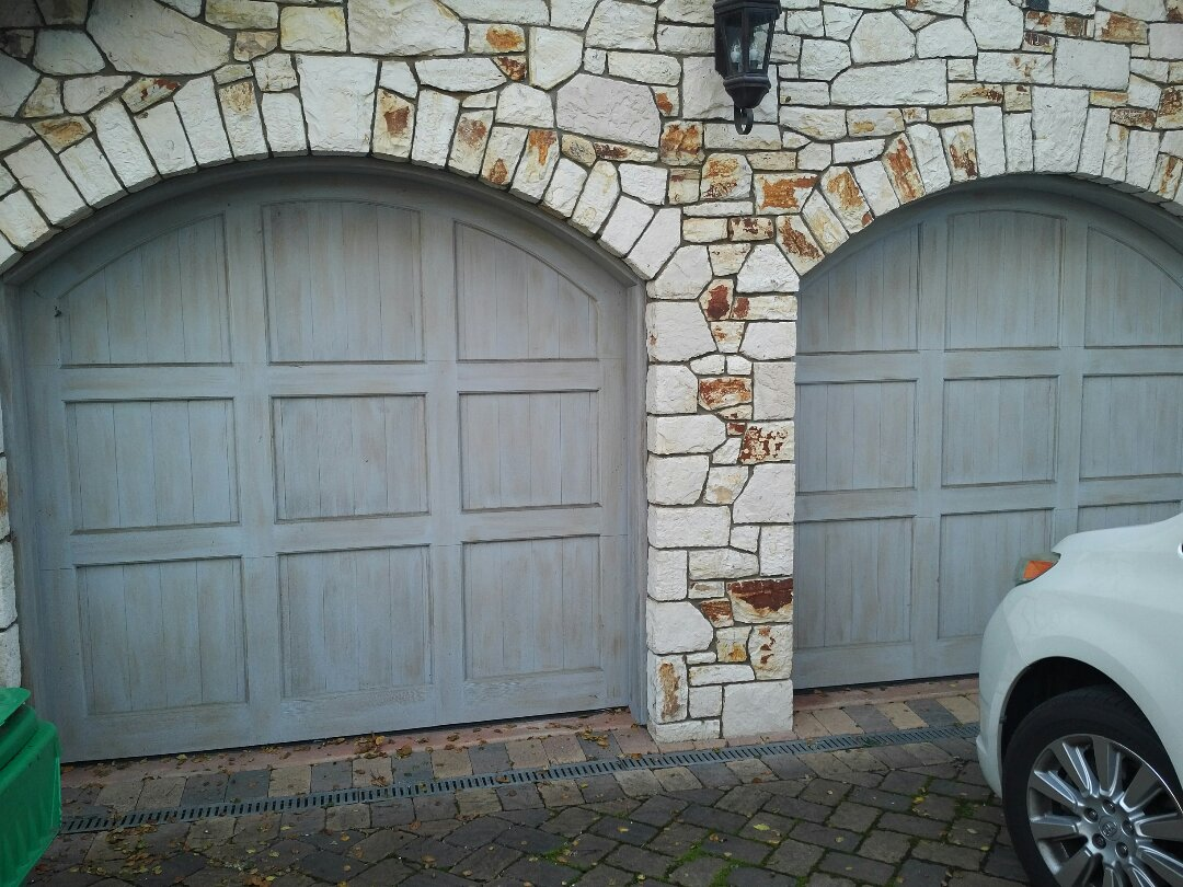 Carmel-by-the-Sea, CA - Service yearly 2 custom wood garage doors