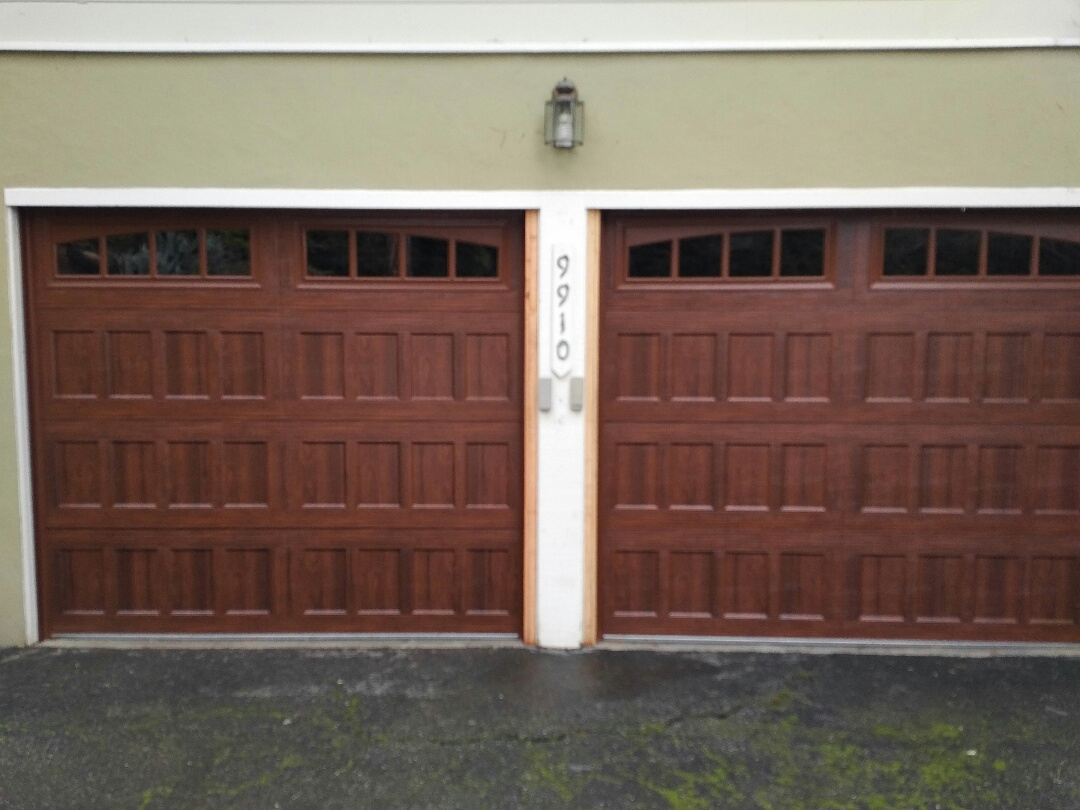 Carmel-by-the-Sea, CA - Two new Amarr Oak Summit garage doors with LiftMaster electric openers