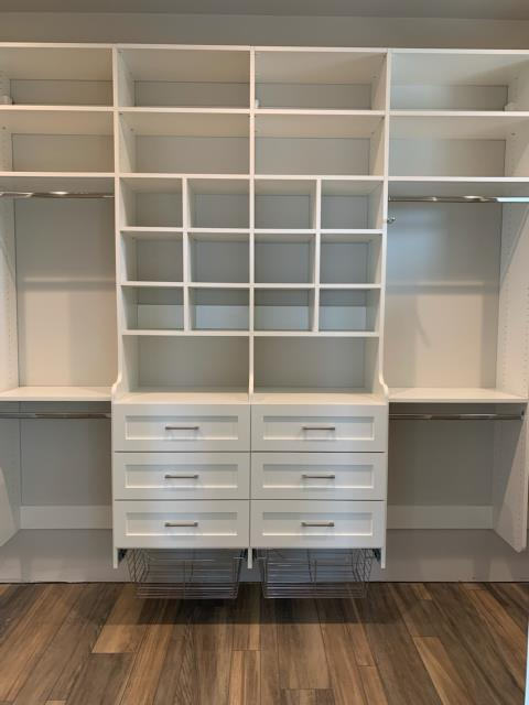 we installed a beautiful custom closet with drawers, a hutch with baskets, adjustable shelves, cubbies, and a hutch.  Alpha wrapped around a window to maximize storage and hanging.  we used long hang and double hang.  The drawer fronts were painted shaker style drawer fronts for a cross between contemporary style closet and a traditional style closet.