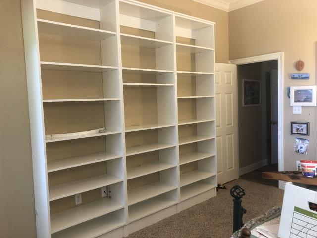 Installed Painted bookcases with wire management and Space for TV