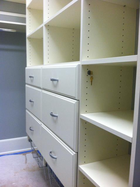 installing a closet designed with a locking drawer, hamper baskets, shelves and hanging.