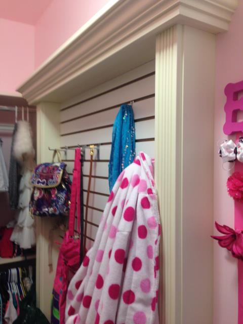 A little girls closet was narrow.  Alpha created slatwall for hooks and added pizzaz with crown and fluting - hooks for hair bows, backpacks, belts and purses.  functional and fun!