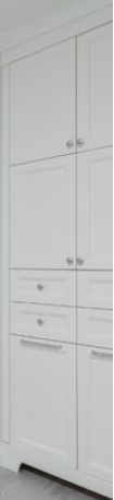 Alpha created in Painted white wood with shaker style doors, a bathroom addition to match existing cabinetry.  To make the bathroom organized and neat hampers for dark and light clothes division were added and linen and general medicine cabinet storage with doors.